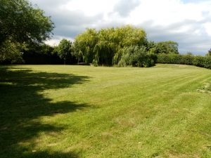 Grass cutting in Suffolk Hedenham nr Bungay Suffolk